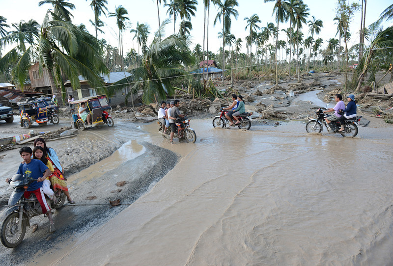 . Motorists traverse a flooded road in New Bataan town, Compostela Valley province on December 5, 2012, a day after the powerful Typhoon Bopha hit the province. At least 274 people have been killed and hundreds remain missing in the Philippines from the deadliest typhoon to hit the country this year, the civil defence chief said December 5.  TED ALJIBE/AFP/Getty Images