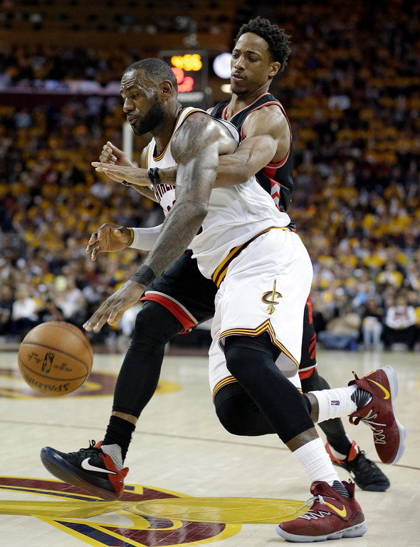 . Cleveland Cavaliers\' LeBron James, left, drives past Toronto Raptors\' DeMar DeRozan in the second half in Game 1 of a second-round NBA basketball playoff series, Monday, May 1, 2017, in Cleveland. The Cavaliers won 116-105. (AP Photo/Tony Dejak)