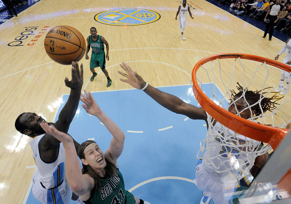 . Denver Nuggets power forward J.J. Hickson (7) goes up over Boston Celtics center Kelly Olynyk (41) for an offensive rebound during the second quarter January 7, 2014 at Pepsi Center. (Photo by John Leyba/The Denver Post)