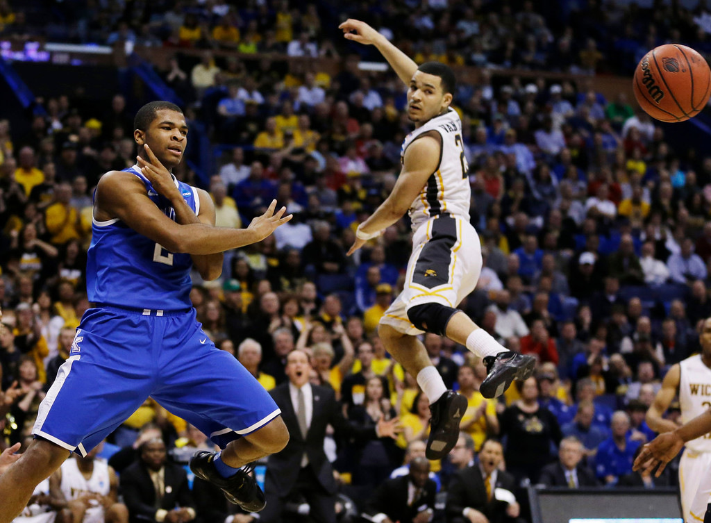 . Kentucky guard Aaron Harrison (2) passes the ball as Wichita State guard Fred VanVleet (23) defends during the first half of a third-round game of the NCAA college basketball tournament Sunday, March 23, 2014, in St. Louis. (AP Photo/Jeff Roberson)