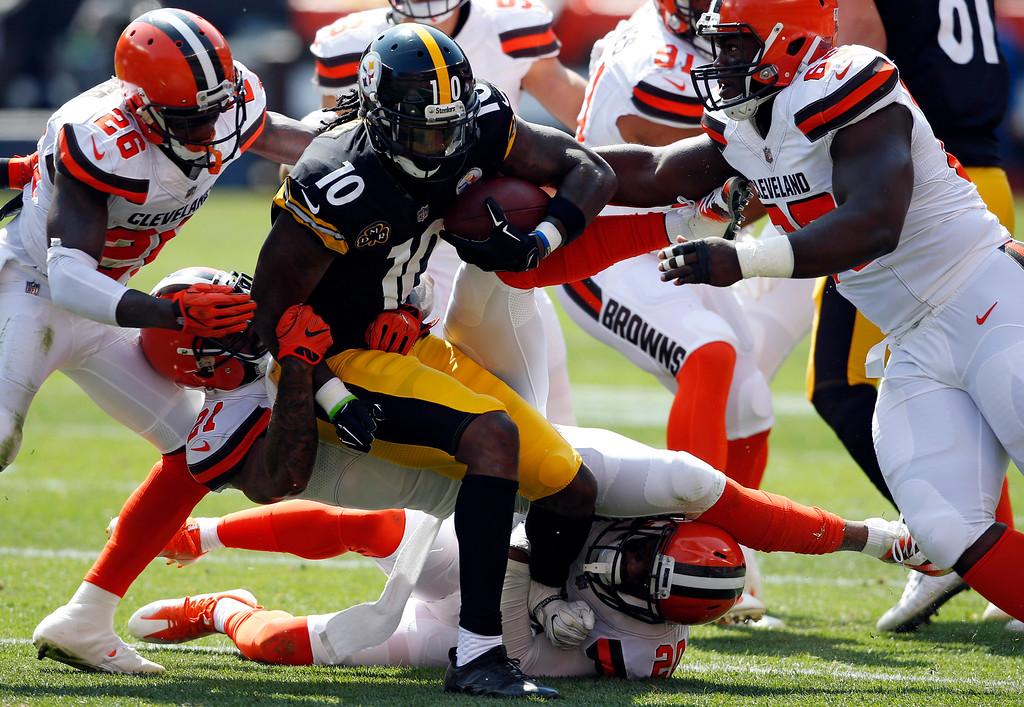 . Pittsburgh Steelers wide receiver Martavis Bryant (10) is stopped by the Cleveland Browns defense during the first half of an NFL football game, Sunday, Sept. 10, 2017, in Cleveland. (AP Photo/Ron Schwane)