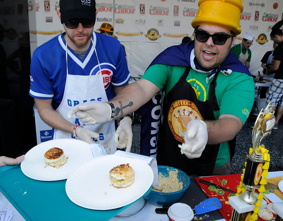 . John Bassett and Matt Laforest whip up angel food cheese deserts. The 11th Annual Grilled Cheese Invitational was held Saturday at the Los Angeles Center Studios, 1201 W. 5th Street, in downtown. Cheese lovers came together to sample grilled cheese sandwiches in a variety of incarnations. Los Angeles, CA 4/20/2013(John McCoy/Staff Photographer
