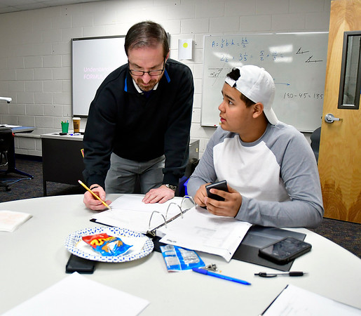 2/12/2020 Mike Orazzi | StaffrBristol Adult Education Instructor Brian Reardon works with Erbin Coello during a class on manufacturing math on Wednesday afternoon.