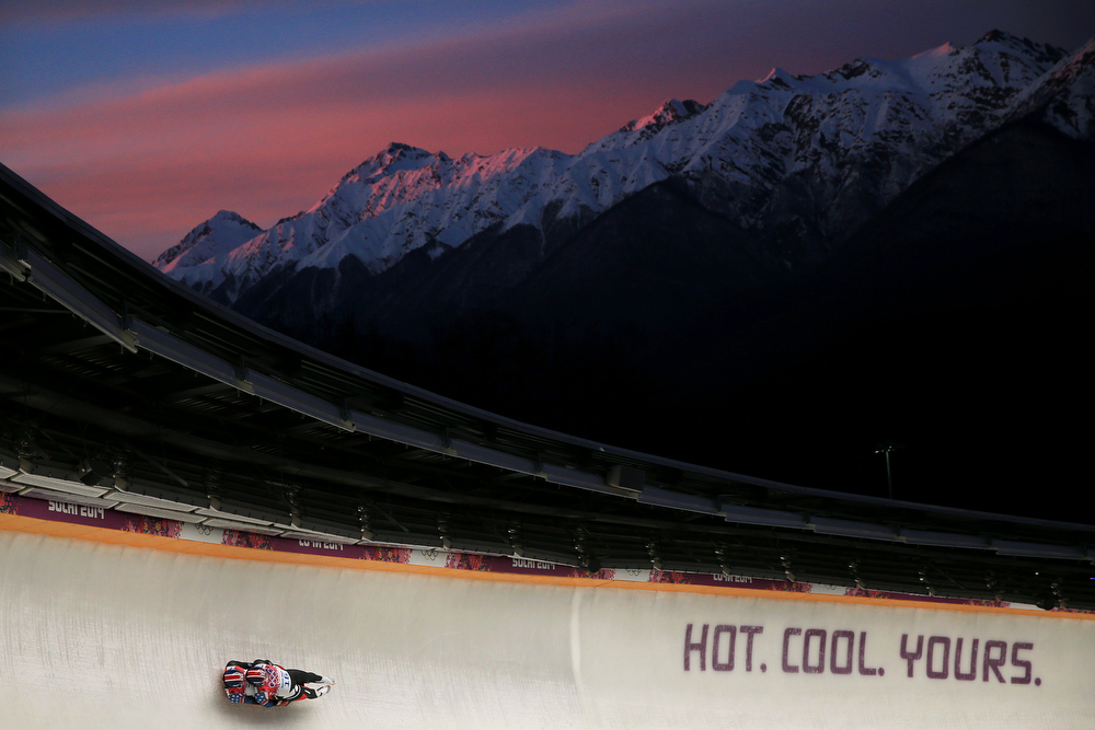 . Matthew Mortensen and Preston Griffall of the United States make a run during the Men\'s Luge Doubles on Day 5 of the Sochi 2014 Winter Olympics at Sliding Center Sanki on February 12, 2014 in Sochi, Russia.  (Photo by Richard Heathcote/Getty Images)