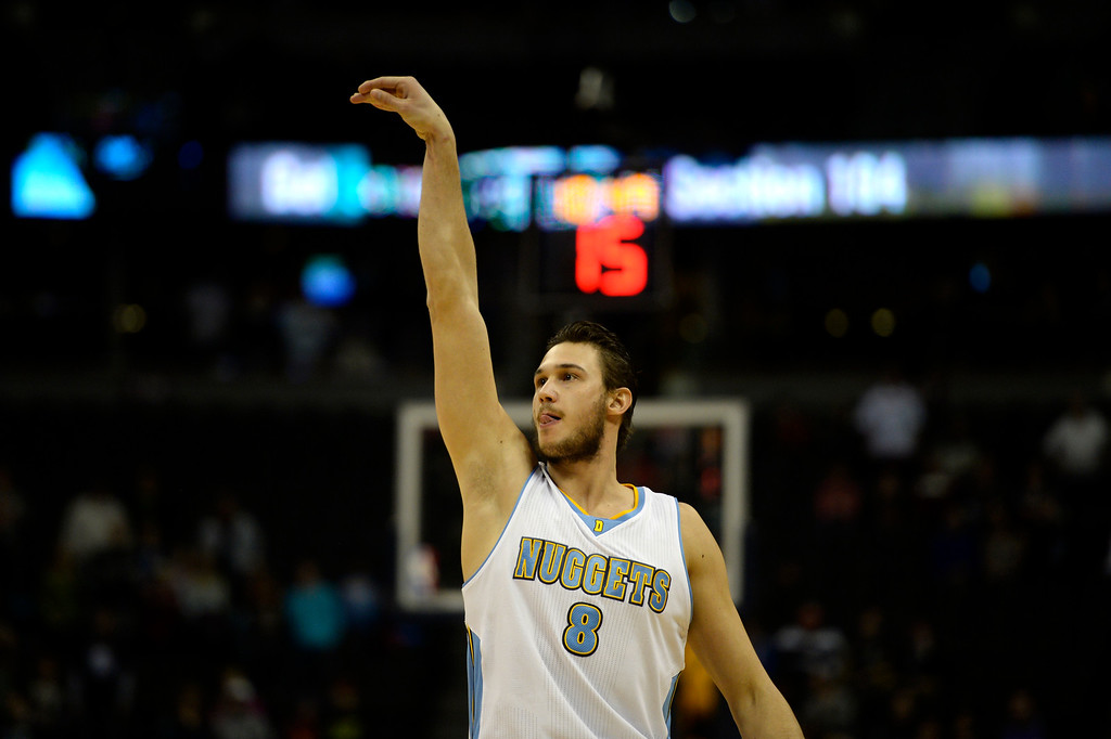. DENVER, CO - MARCH 03: Danilo Gallinari (8) of the Denver Nuggets holds his shot as he makes a three against the Milwaukee Bucks during the first quarter of action. The Denver Nuggets hosted the Milwaukee Bucks at the Pepsi Center on Tuesday, March 3, 2015. (Photo by AAron Ontiveroz/The Denver Post)