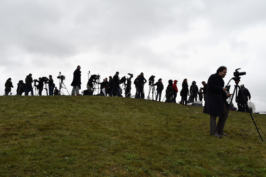 . Media are seen near an industrial estate near to where it is thought the suspects linked to the Charlie Hebdo massacre are holding a hostage on January 9, 2015 in Dammartin en Goele, France.  A huge manhunt for the two suspected gunmen in Wednesday\'s deadly attack on Charlie Hebdo magazine has entered its third day with major police activity surrounding the village of Dammartin en Goele where the suspects are holed up.  (Photo by Pascal Le Segretain/Getty Images)