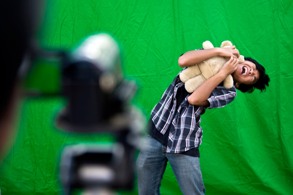 . Gabriel Oliver, 12, acts out a scene of a commercial in front a greenscreen while being film by visual fx artist Roger Huynh during an after school class at Oswalt Academy in Walnut on Friday, Feb. 15, 2013. Huynh has worked on �Wreck it Ralph� �BOLT� and �Lord of the Rings.\' (SGVN/Staff photo by Watchara Phomicinda)