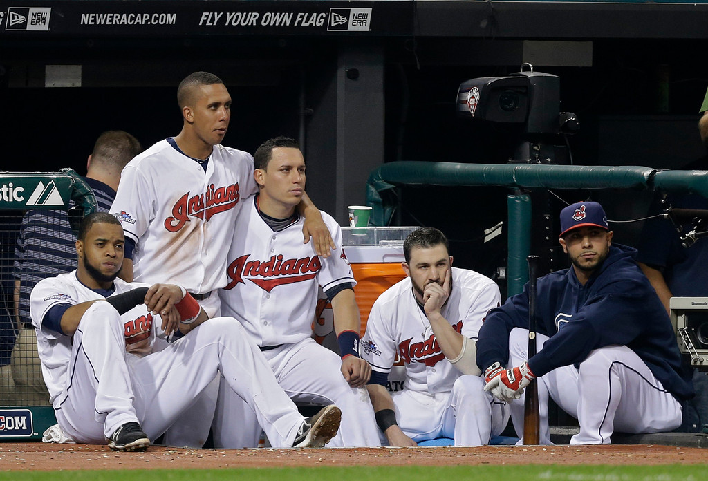 . Cleveland Indians\' Carlos Santana, Michael Brantley, Asdrubal Cabrera, Jason Kipnis and Mike Aviles, from left, watch the Tampa Bay Rays celebrate a 4-0 win over the Indians in the AL wild-card baseball game Wednesday, Oct. 2, 2013, in Cleveland. (AP Photo/Tony Dejak)