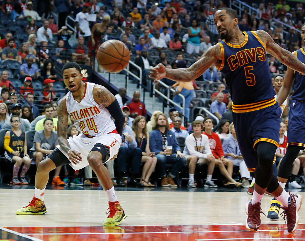 . Cleveland Cavaliers guard J.R. Smith (5) chases a loose ball as Atlanta Hawks forward Kent Bazemore (24) looks on in of Game 4 of the second-round NBA basketball playoff series, Sunday, May 8, 2016, in Atlanta. (AP Photo/John Bazemore)