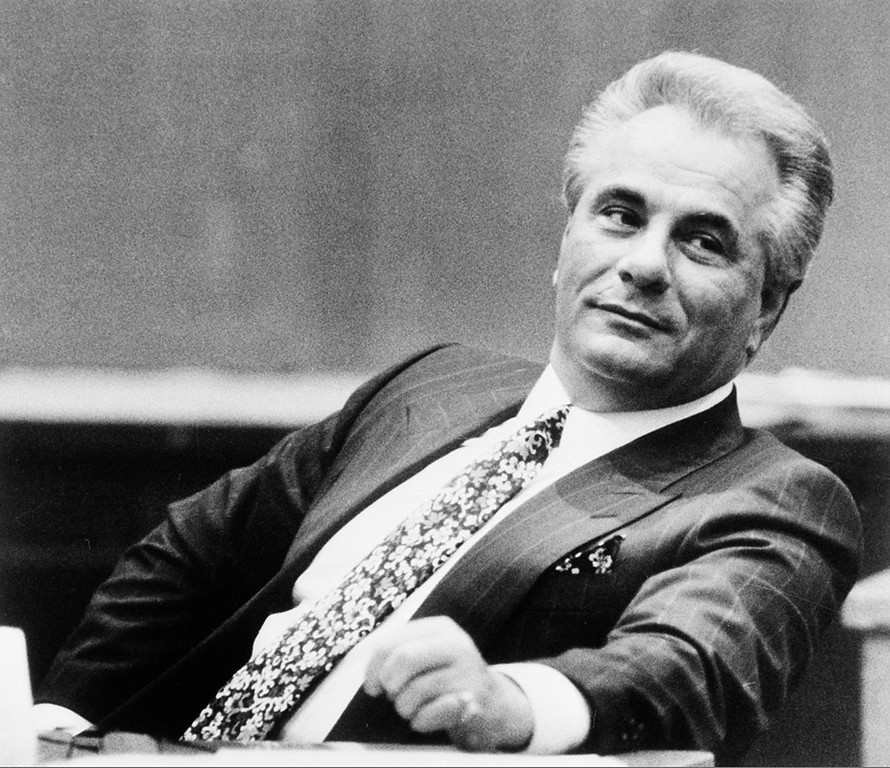. Reputed Gambino family crime boss John Gotti leans back during a break in testimony in New York Supreme Court in Manhattan, Jan. 23, 1990.  Gotti and a co-defendant are charged with conspiracy and assault in connection with a shooting of a carpenter\'s union leader.  (AP Photo/Daniel Sheehan)