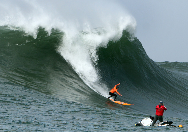 . Tyler Fox of Santa Cruz carves into the face of a giant wave at Mavericks in Half Moon Bay on Friday during the semifinal heat of the Mavericks Invitational surf competition. (Kevin Johnson/Sentinel)