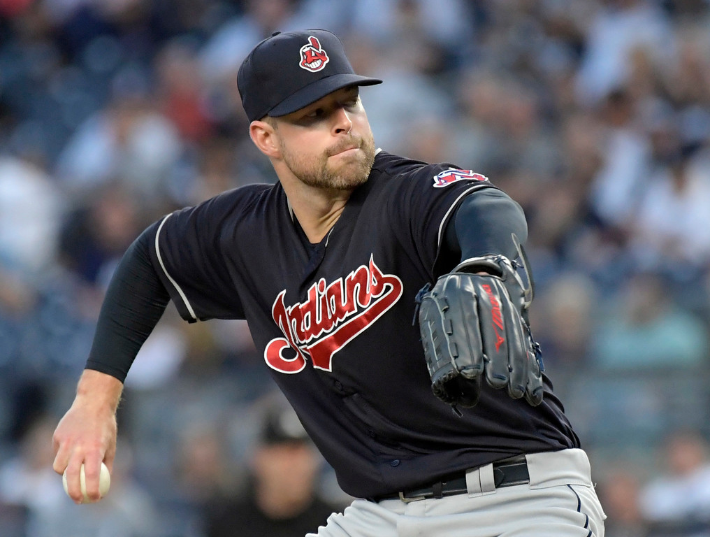 . Cleveland Indians pitcher Corey Kluber delivers the ball to the New York Yankees during the first inning of a baseball game, Monday, Aug. 28, 2017, at Yankee Stadium in New York. (AP Photo/Bill Kostroun)