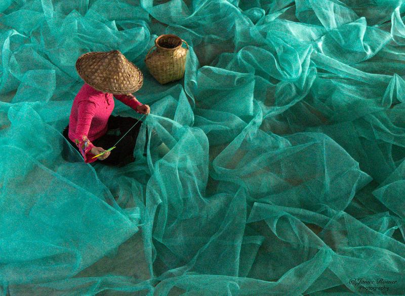 Woman fixing a net