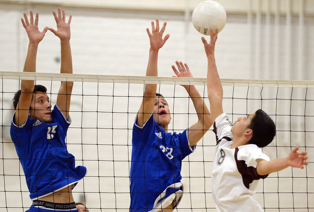 . El Rancho\'s Bryan Rojas (#15) and Dimitric Lozano (#23) jump up to block a shot as they play Bell Gardens in their non-league game at El Rancho High School in Pico Rivera on Friday March 28, 2014. Bell Gardens defeated El Rancho 3-2 games. (Staff Photo by Keith Durflinger/Whittier Daily News)