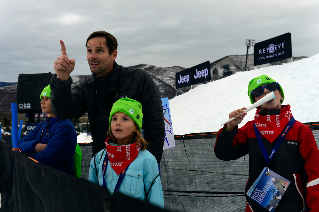 . ASPEN, CO. - JANUARY 24:   Thomas Deardorff, and his children Jack, 12, left, Kate, 7, center and  William Deardorff, 10, watch the men\'s Slopestyle elimination at the 2013. Aspen X Games on Buttermilk Mountain January 24, 2013. The family, from California, happened to be vacation in Aspen the same week as X Games and decided to spend some time at the event.  (Photo By Mahala Gaylord / The Denver Post)