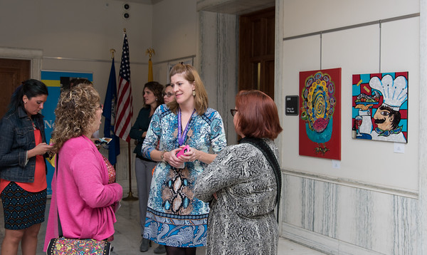 "101216 Wesley Bunnell | Staff Mayor Erin Stewart and the Commission on the Arts held a reception Wednesday evening at City Hall titled ""Leading by Example: Works by New Britain Public School Art Teachers&quote;. Fourteen teachers from across the district have work on display until Nov 25. Leona Clerkin, the School District's Fine Arts Coordinator shown in the middle."