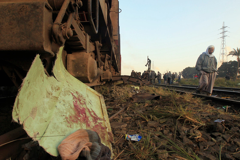 . Belongings and traces of blood of victims are seen at the wreckage of a military train crash in the Giza neighbourhood of Badrashin, about 40 km (25 miles) west of Cairo, January 15, 2013. A military train carrying young recruits to an army camp derailed in a Cairo suburb on Tuesday, killing 19 people and injuring 107, Egypt\'s health ministry spokesman said.   REUTERS/Mohamed Abd El Ghany