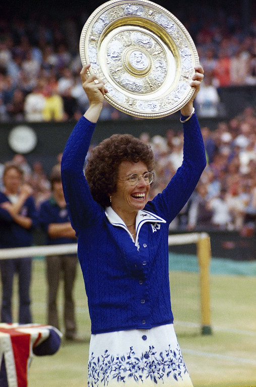 . 1975: American women, represented by Susan Brownmiller, Kathleen Byerly, Alison Cheek, Jill Conway, Betty Ford, Ella Grasso, Carla Hills, Barbara Jordan, Billie Jean King, Carol Sutton, Susie Sharp and Addie Wyatt. U.S. tennis star Billie Jean King holds up trophy after winning her sixth singles final at Wimbledon in London, July 4, 1975. (AP Photo)