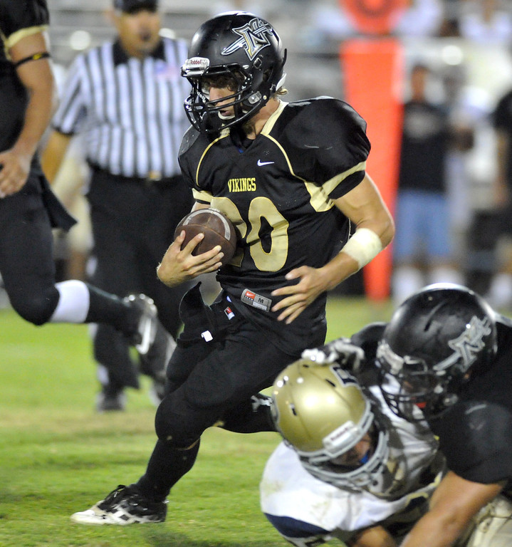 . Northview\'s Damian Lavin (#20) gains yardage on a run as they play Rowland in their non-league game at Covina District Field in Covina on Friday September 13, 2013. Northview beat Rowland 28-0. (San Gabriel Valley Tribune/Staff Photo by Keith Durflinger)