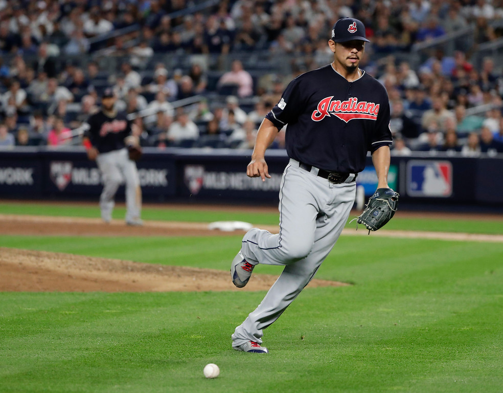 . Cleveland Indians pitcher Carlos Carrasco chases down a soft ground ball hit by New York Yankees\' Aaron Hicks during the sixth inning in Game 3 of baseball\'s American League Division Series, Sunday, Oct. 8, 2017, in New York. (AP Photo/Frank Franklin II)