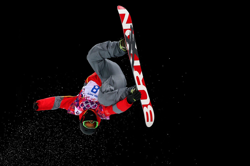 . Shi Wancheng of China competes in the Snowboard Men\'s Halfpipe Semifinal on day four of the Sochi 2014 Winter Olympics at Rosa Khutor Extreme Park on February 11, 2014 in Sochi, Russia.  (Photo by Mike Ehrmann/Getty Images)