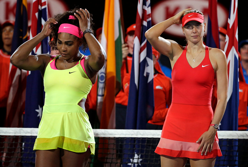 . Winner Serena Williams of the U.S., left, and  runner-up Maria Sharapova of Russia, right, wait for the trophy presentation after the women\'s singles final at the Australian Open tennis championship in Melbourne, Australia, Saturday, Jan. 31, 2015. (AP Photo/Vincent Thian)