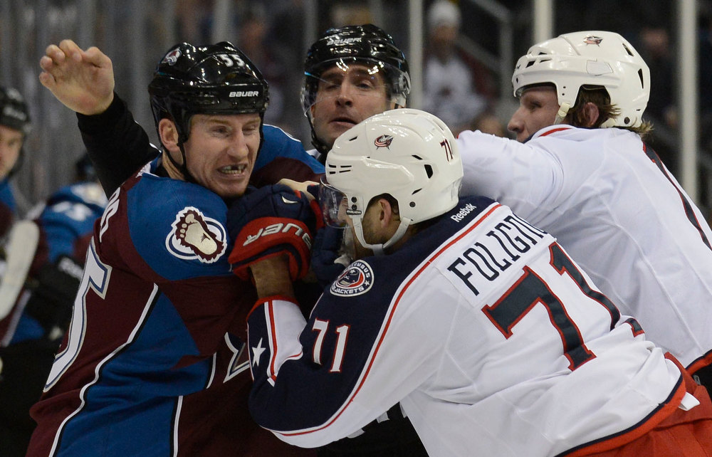. DENVER, CO. - JANUARY 24: Colorado Avalanche left wing Cody McLeod (55) takes on Columbus Blue Jackets left wing Nick Foligno (71) and Columbus Blue Jackets right wing Derek Dorsett (15) along the boards during the second period at Pepsi Center. The Colorado Avalanche take on the Columbus Blue Jackets in NHL action.  (Photo By John Leyba / The Denver Post)