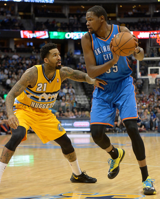 . Oklahoma City Thunder small forward Kevin Durant (35) is guarded by Denver Nuggets small forward Wilson Chandler (21) during the third quarter December 17, 2013 at Pepsi Center. (Photo by John Leyba/The Denver Post)