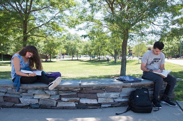 08/29/19 Wesley Bunnell | Staff Ambarlyn Angeletti, L, and Victor Montanez take advantage of the warm weather to study outside on CCSU's campus on August 29, 2019.