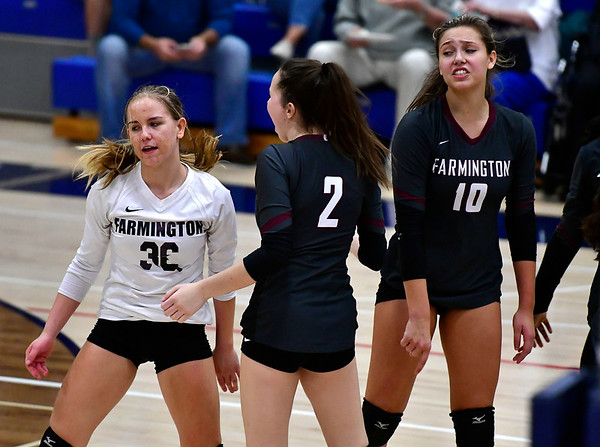 11/1/2018 Mike Orazzi | Staff Farmington High School's Carolyn Piera (36), Katherine Siuta (2) and Holly Picchioni (10) during the CCC Volleyball Tournament held at Avon High School Thursday night.