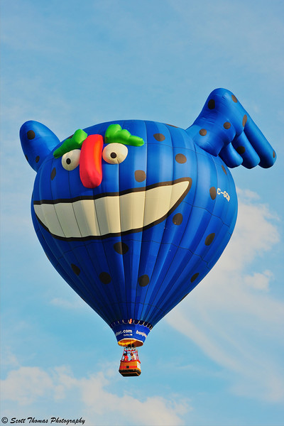 A big funny face from Quebec, Canada floats over the 2011 Syracuse Balloonfest.