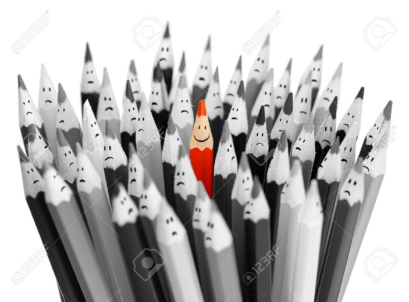 19377657-One-bright-color-smiling-pencil-among-bunch-of-gray-sad-pencils-Stock-Photo.jpg