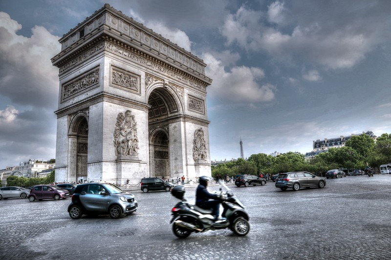 Arc de Triomphe stands at the western end of the Champs-Élysées