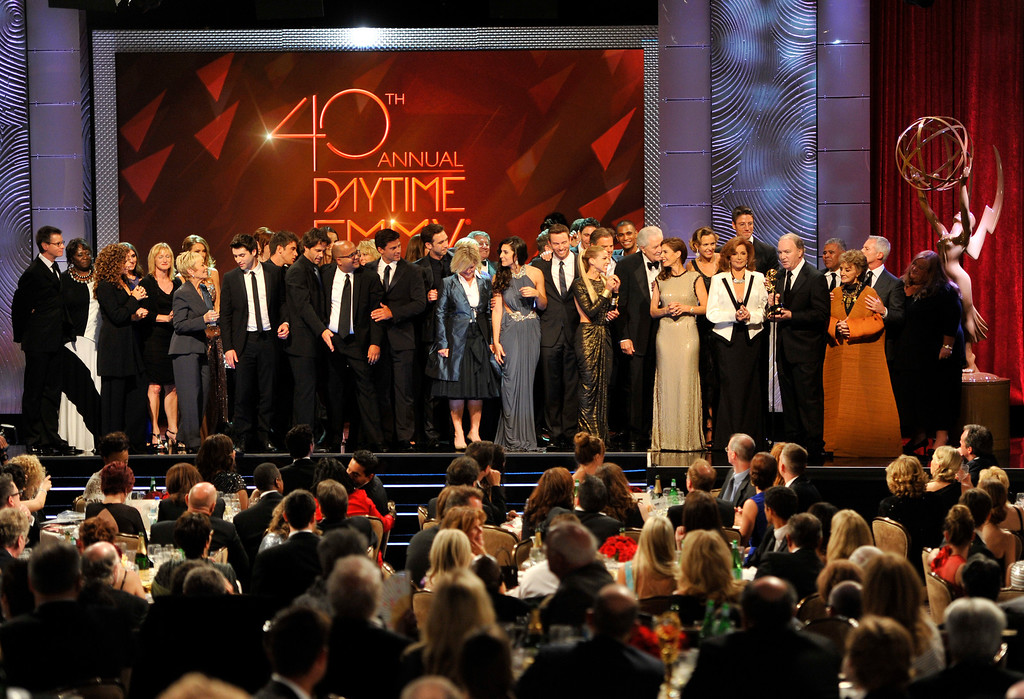 """. The cast and crew of \""""Days of Our Lives\"""" accept the award for outstanding drama series at the 40th Annual Daytime Emmy Awards on Sunday, June 16, 2013, in Beverly Hills, Calif. (Photo by Chris Pizzello/Invision/AP)"""