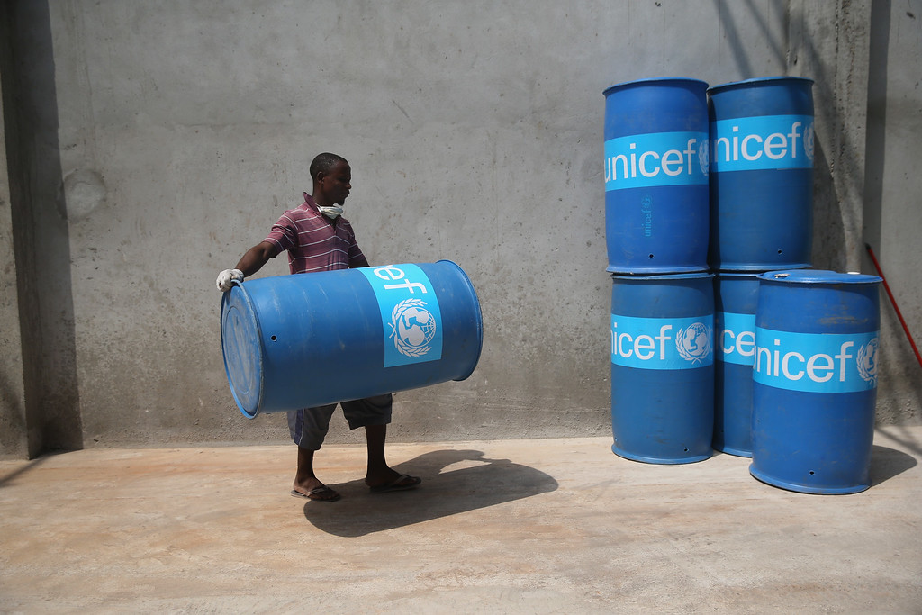 ". UNICEF workers assemble ""school infection prevention kits\"" to stop the spread of Ebola in schools scheduled to open next week on January 28, 2015 in Monrovia, Liberia.  (Photo by John Moore/Getty Images)"