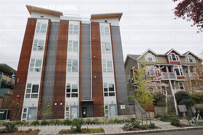 This modern development at 422 11th Ave. E  in the Capital Hill neighborhood of Seattle, Washington dwarfs legacy structures nearby as seen April 13, 2015.