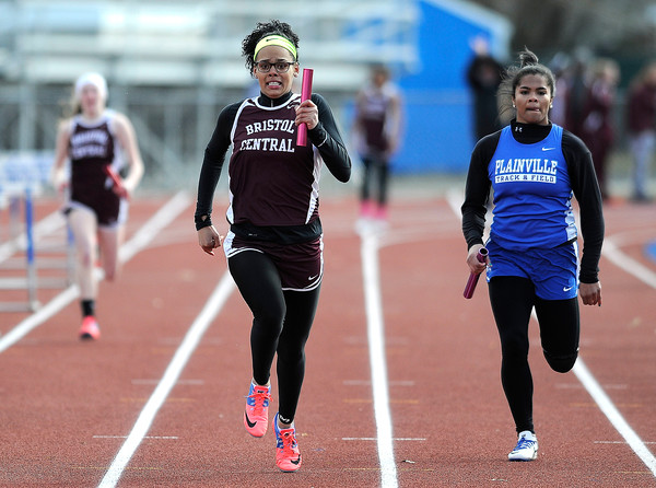 4/5/2018 Mike Orazzi   Staff Bristol Central's Shy-Ann Whitten in the 4x100 relay at Plainville High School Thursday afternoon.