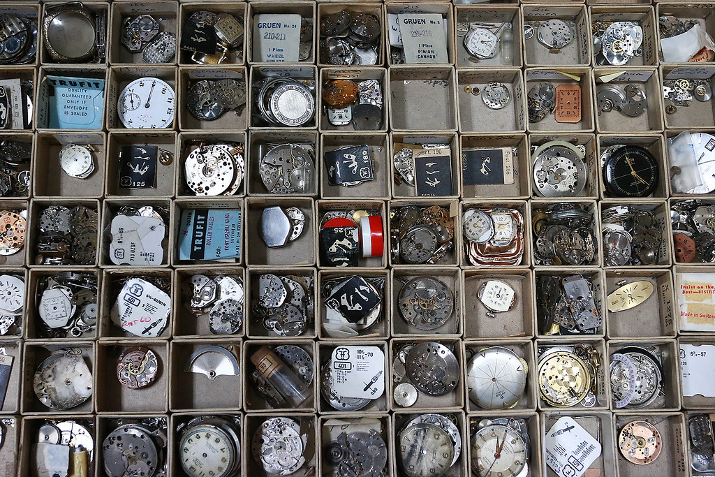 . John Lynch shows off a drawer full of watch parts in his shop at John\'s Watch and Jewelry in Lunenburg. SENTINEL & ENTERPRISE/JOHN LOVE