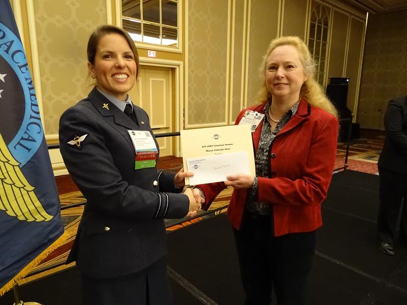 AsMA International Scholarship is presented to Bonnie Posselt, MBChB (E), by AsMA President Dr. Valerie Martindale.