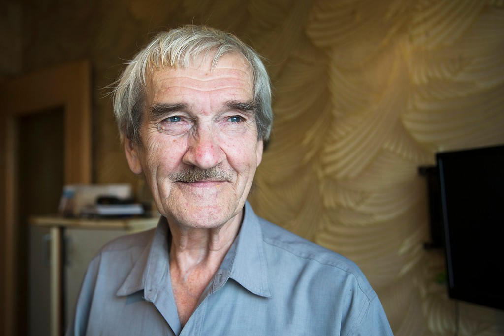 """. FILE In this file photo taken on Thursday, Aug. 27, 2015, former Soviet missile defense forces officer Stanislav Petrov poses for a photo at his home in Fryazino, Moscow region, Russia. Petrov, a former Soviet military officer known in the West as \""""The man who saved the world\'\' for his role in averting a nuclear war over a false missile alarm, died in May at age 77. (AP Photo/Pavel Golovkin)"""
