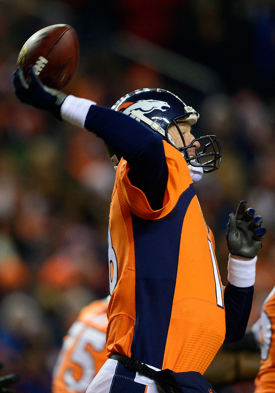 . Peyton Manning (18) throws during the second quarter against the San Diego Chargers at Sports Authority Field at Mile High in Denver on December 12, 2013. (Photo by AAron Ontiveroz/The Denver Post)