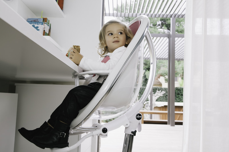 Mima_Moon_Lifestyle_White_Highchair_Girl_Looking_At_Parent.jpg