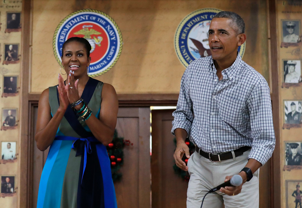 . President Barack Obama, joined by first lady Michelle Obama, arrives to speak during an event to thank service members and their families at Marine Corps Base Hawaii in Kaneohe Bay, Hawaii, Sunday, Dec. 25, 2016. (AP Photo/Carolyn Kaster)