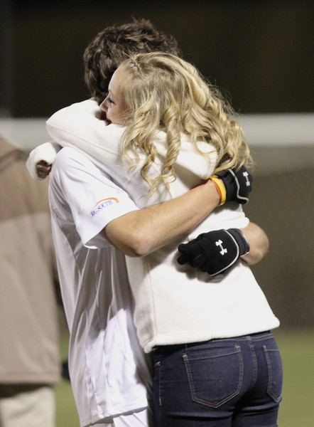 Number 28, Trey Lewis, embraces a friend after the game.