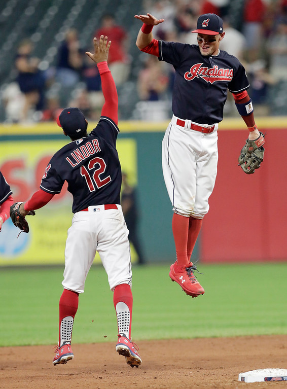 . Cleveland Indians\' Brandon Guyer, right, and Francisco Lindor celebrate after the Indians defeated the Kansas City Royals 9-3 in a baseball game Tuesday, Sept. 4, 2018, in Cleveland. (AP Photo/Tony Dejak)