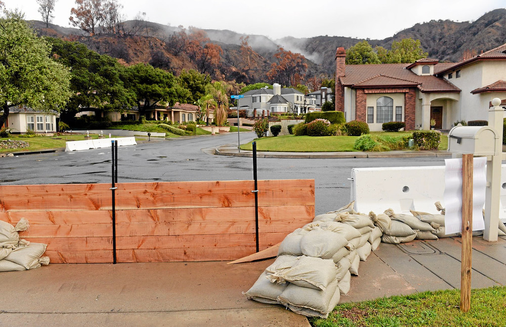 . Sanbags, K-rails and wood barriers are in place at Englewild Drive and Rose Drive in Glendora in preparation of the oncoming storm on Thursday February 27, 2014. (Staff Photo by Keith Durflinger/San Gabriel Valley Tribune)