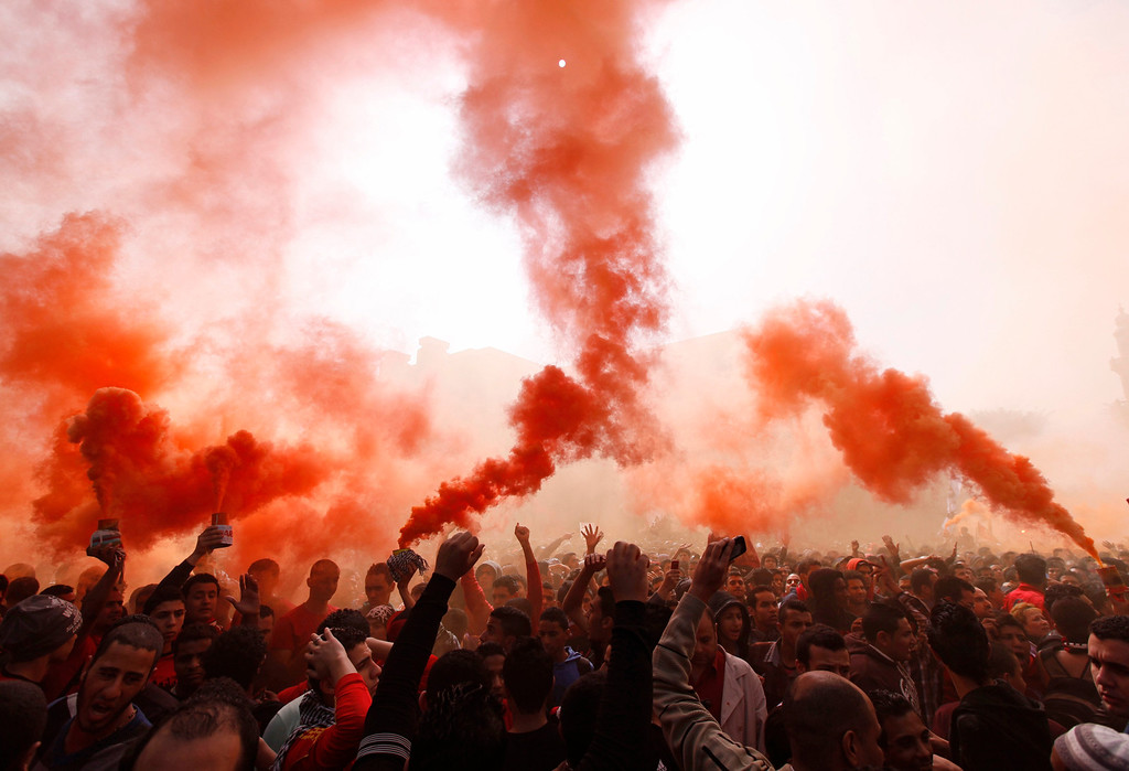 """. Al-Ahly fans, also known as \""""Ultras\"""", shout slogans against the Interior Ministry in front of the Al-Ahly club after hearing the final verdict of the 2012 Port Said massacre in Cairo March 9, 2013.  REUTERS/Amr Abdallah Dalsh"""