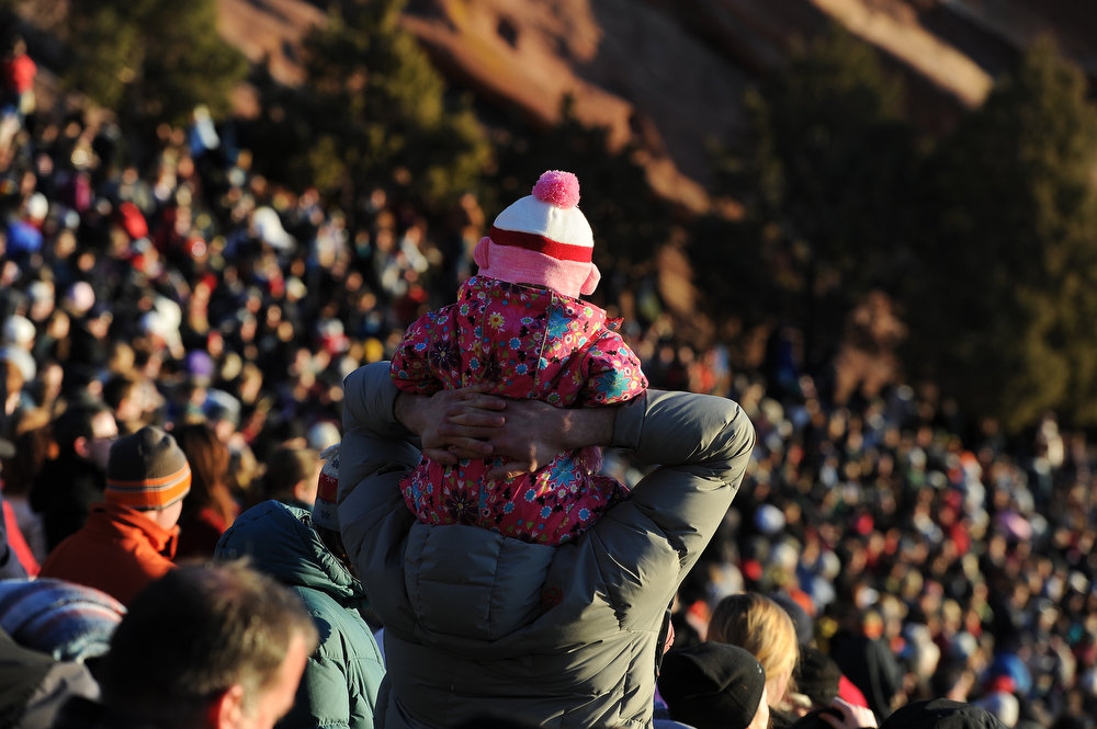. Isaac Mooberry, of Evergreen, holds his 2 year old daughter Michaela, up on his shoulders for a better view during the service.Thousands of people turned out for the sixty sixth annual Easter sunrise service at Red Rocks Amphitheatre in Golden on March 31st, 2013.The sun rose at 6:45 am under cloudless skies and this year\'s service was pleasant with warmer temperatures than in previous years.  The service, sponsored by the Colorado Council of Churches, was led by Reverend Dr. Jim Ryan and presided over by Reverend Dr. Janet Forbes.   (Photo By Helen H. Richardson/ The Denver Post)