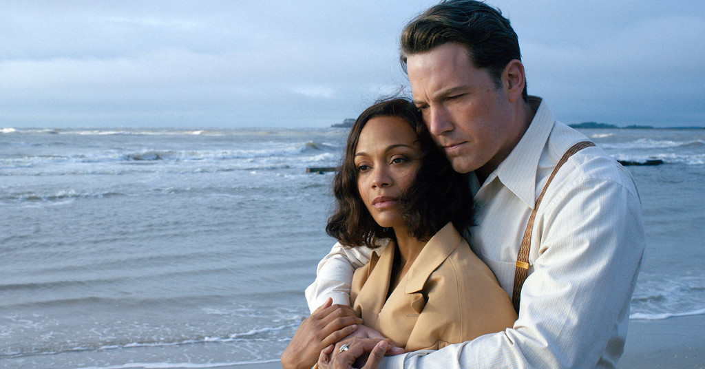 ". Zoe Saldana, left, and Ben Affleck in a scene from ""Live By Night,\"" a movie involving the world of organized crime, in theaters Jan. 13. (Claire Folger/Warner Bros. Entertainment via AP)"