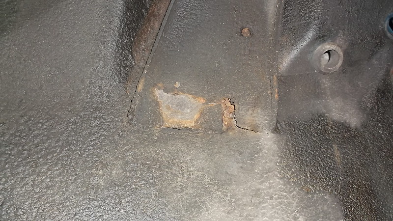 Rust hole in inner wing at damper reinforcement - a common problem